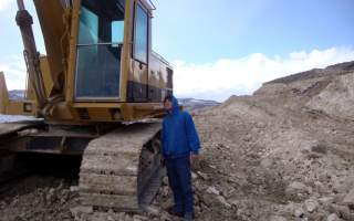 Jake Anderson and excavator in Northern Lights
